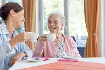 carer and client having tea